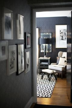 Monochromatic living room with black walls.