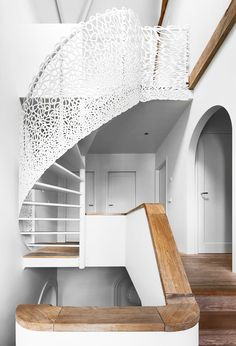 Party up top, serious down below: that spiral staircase adds a refreshing kick this space. Mop those wood floors with our Floor Cleaner for double the refreshing kick #OriginalFig #AustralianWhiteGrapefruit Image by Filip Dujardin #stairway #minimalism #white #spiralstaircase