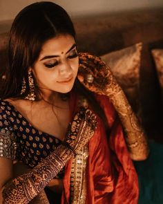This bridal portrait painted in dramatic hues of bold totally screams perfection! Mehendi Photography, Indian Wedding Photography Poses, Bride Photography, Portrait Photography, Indian Photoshoot, Bridal Photoshoot, Bridal Poses, Bridal Portraits, Engagement Dress For Groom