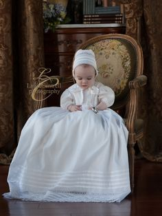 Sweet Hawkins in his Christening Gown and bonnet design by Mela Wilson Heirloom Children's Clothing.