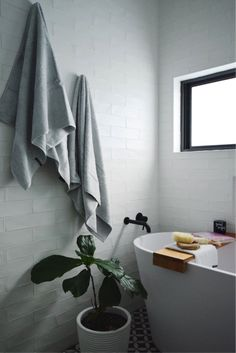 Styling with towels? Yep, it's totally a thing and here are our top ideas to use towels to add warmth and interest to your bathroom!