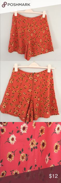 Urban outfitter high waisted floral shorts High waist, flouncy fit. Perfect with a crop top or 2 shirt. Has the look of a skirt but safety of a short. Kimchi Blue. One slight mark (looks like a thread discoloration. Not noticeable unless very up close - see pic 3. Urban Outfitters Shorts Skorts