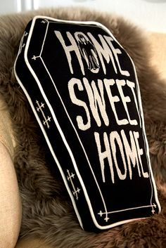 Not to be morbid, but nothing says Halloween quite like Pier 1's Home Sweet Home Coffin Pillow. Since the options are trick or treat, why not go with the former and make your indoor or outdoor environment a lot more fun?