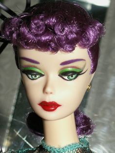 Barbie with a Concord Grape hair color was hand-rooted by MiKelman in the style of a #1-#2-#3-#4 Ponytail hair style, on a pale Caucasian reproduction Barbie head that has the modern feature of a swiveling neck joint, so it fits onto a variety of modern or contemporary Barbie bodies from 1977's SuperStar , 1990's Shani, 2000's Silkstone & 2004's ModelMuse!