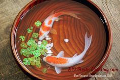 A couple of fish resting by clover with four leaves lifelike painting in resin