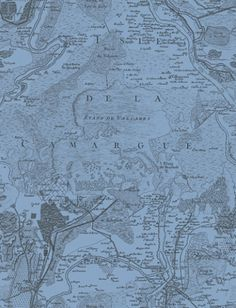 Voyage (PCL002/06) - Designers Guild Wallpapers - Inspired by an antique map of Camargue; a region in France.  A detailed map with French names. Available in range of colours – shown in the black on mid blue. Paste the wall Please request a sample for true colour match.