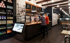 Black Porcelain Enamel Pendants Make Bold Statement in New York Deli | #shop #exposedbeams #subwaytile #hip