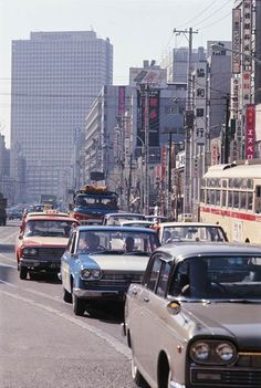 Shinbashi, Tokyo, Looking to Kasumigaseki Building… Japanese Cars, Japanese Culture, Vintage Japanese, Showa Period, Showa Era, Aesthetic Japan, Japanese Aesthetic, Oriental Countries, Tokyo Olympics