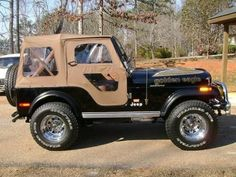 "Jeep CJ7 - mine was a burgundy red  color called ""Thanks Vermillion""  with a matching top."