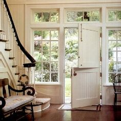 Love the stairs and hand rail, & that front door!