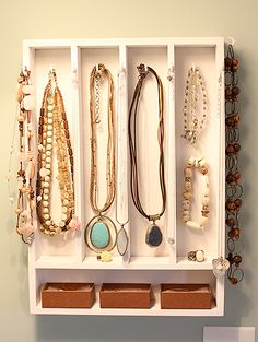 Jewelry Hanger {made of kitchen drawer tray and small hooks}<- I am so doing this!! Because my kitchen drawers in the house are too small for tray. Now I can upcycle. Oooh I'll spray paint it too!! <3