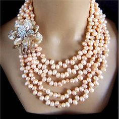Could be done with inexpensive water pearls and a broach. Looks classy!!