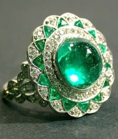 Emerald and Diamond Ring Platinum, set to the center with one cabochon emerald bordered by assorted small round diamonds and calibre-cut emeralds, signed Tiffany. Art Deco Jewelry, Bling Jewelry, High Jewelry, Jewellery, Antique Jewelry, Vintage Jewelry, Emerald Jewelry, Emerald Rings, Emerald Diamond