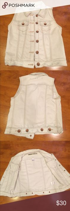 Dollhouse Denim Vest size XS Most adorable, buttery soft distressed denim vest on the planet. It's by Dollhouse. Very comfy and perfect for summer into fall. No defects or stains. It is distressed from the factory and just yummy. This is the denim vest everyone wants! Tag reads 69%cotton 30% polyester and 1% spandex. From my home- fresh and clean. Dollhouse Tops