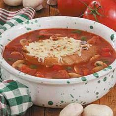 Contest-Winning Pizza Soup Recipe -This robust soup is a family favorite, and it's a big hit with my canasta group as well. I top each bowl with a slice of toasted bread and cheese, but you can have fun incorporating other pizza toppings such as cooked sausage. —Jackie Brossard Kitchener, Ontario