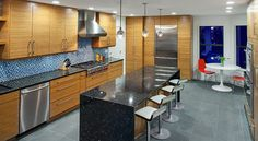 Check out these beautiful bamboo cabinets in this kitchen by Austin interior design firm Dawn Hearn Interior Design