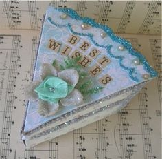 Paper cake slice decorated with glitter , flowers, beads and text . From Speckled Egg  Fliker photostream