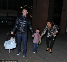 Very grown up! Wayne Rooney celebrates his 28th with a low key meal with his wife Coleen and sons Kai and Klay