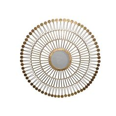 A modern wall mirror with an air of Scandinavian luxury, this decadent starburst design is at once an eye-catching art piece and a decorative looking glass. Forged from iron and enhanced with a gold foil finish, the round reflective center features an elegant beveled glass detail. Each individual iron spire is topped with a single penny round to enhance the circular structure of the frame.