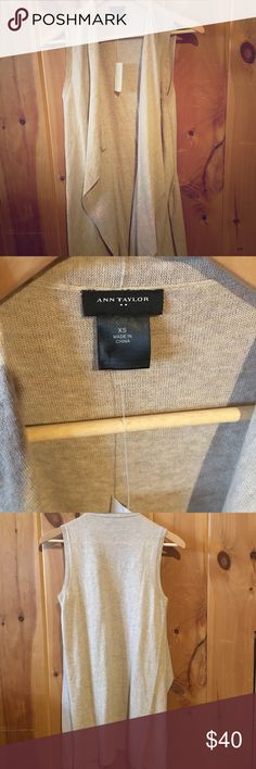 NWT Ann Taylor Factory sleeveless Flyaway Sweater NWT never worn, beige, light weight sleeveless open flyaway. Perfect for any season! On a 5' person the length goes to about the knee. Average length is mid thigh. Goes with everything from denim to leggings to dresses! Ann Taylor Sweaters Cardigans