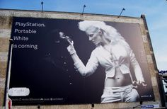 """""""PlayStation Portable White is coming"""". Sony doesn't shy away from controversial ads, which they prove with this billboard in the Netherlands for the launch of PSP White in 2006 [751x491]"""