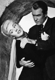 James Stewart and Kim Novak in VERTIGO (Alfred Hitchcock, 1958). Very mysterious film. Hitchcock only used the best-looking actors and actresses, but it was always the women who were crazy??? Amazon.