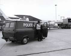 A officer of Greater Manchester Police on the airfield at Manchester Airport. One of a series of images taken in 1978 that record various aspects of the work of the Force. www.gmpmuseum.co.uk