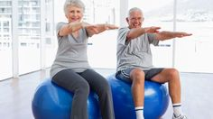 Happy senior couple doing stretching exercises on fitness balls in the medical office by Wavebreakmedia. Happy senior couple doing stretching exercises on fitness balls in the medical office Pilates, Hiit, Cardio, Fitness Senior, Stability Ball Exercises, Stretching Exercises For Seniors, Abs Workout Video, Exercise Videos, Ab Workouts
