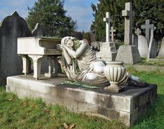 Asleep on her grand piano. Gladys Spencer, a pianist who died age 34 in 1931 City of London cemetery, Manor Park,