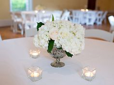 White and blush flowers were used to create these beautiful centerpieces in silver mercury glass containers.  | The Sonnet House | Photo by Browne Photography