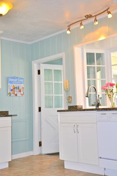 Love how airy this is with the white and blue. Love the light over the sink Decor, Wood, Home, Kitchen Remodel, Remodel, New Homes, House, Home Projects, Painting Wood Paneling