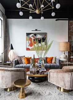 Eclectic monochrome living room decor with burnt orange accessories