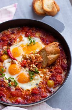 Tackle a hangover with this Eggs + Tomato Breakfast Skillet.