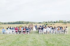 Pasture ceremony at East Lynn Farm, a historic working farm and wedding venue in Northern Virginia. // Photo by Lindsay Fauver Photography.