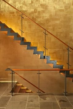 Stairwell is Venetian plaster lit w/ very bright LED light. Effect dramatic, but lines & other materials keep it simple & elegant