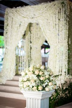 Fresh Orchid Curtain: A grand entrance to the dinning hall. Design by ME executed by The Flowers Factory :This 1.5 million orchids curtain  took 15 people 3 days to make it! THANK YOU