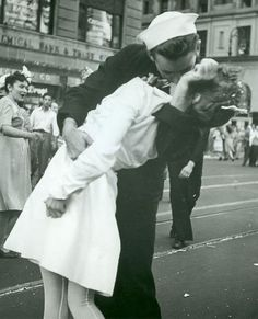 The story...  This scene took place in Times Square when the end of WWII was announced. There was a great celebration and a sailor took a nurse nearby and kissed her, and this picture was taken by a bystander. After the kiss, he walked one way and she walked the other without any further contact.   Cute :)