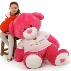 Enormous adorable, cuddly hot pink teddy bear Cha Cha Big Love wears a personalized 5 word message on her custom heart design shirt for Valentine's Day gifts or anytime.