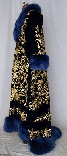 OTTOMAN EMBROIDERED CAFTAN, 19TH C Sapphire blue velvet w/ heavy gold 3-dimensional floral & vine embroidered front & back, V-neck, blue dyed fox fur collar & hem trim. Sideway