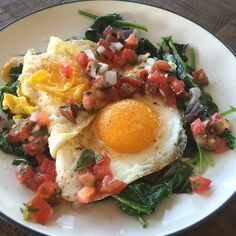 """Sometimes your egg wants to be a brat in the pan and this happens. ""It all eats the same"", as a friend says.  The lime and cilantro from the pico pair so well with the eggs and spinach. #Paleo #primal #paleodiet #paleohope #paleobreakfast #cleaneating #dairyfree #glutenfree #grainfree #nutfree #soyfree #freerangeeggs #eatrealfood #eatingclean #eattheyolks #eatforhealth #eattherainbow #fitfood #fastpaleo #foodforhealth"
