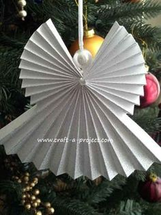 This Christmas Angel Ornament is a pretty easy Christmas Craft to make... once you understand how the pieces go together. I tried a number of times and none of them turned out the way I wanted. Christmas Angel Ornament with Craft A Project.
