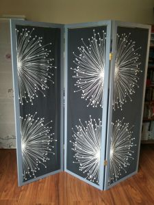 DIY room divider. The tutorial is pretty sparse, but it's pretty and I bet once you get it down you could make several pretty easily.