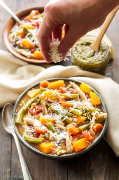 Pesto Chicken and Vegetable Soup | A hearty soup full of vegetables, shredded chicken, cannellini beans, pesto and topped off with parmesan cheese!