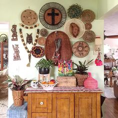 Happy hump day  . This eclectic basket wall has been so much fun this past year but once it comes down to paint this side of the kitchen I don't think it's going back up.  . . All found thrifting or collected while traveling over the years except for what's tagged.