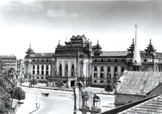 Rangoon City Hall  (1945).  The damage in the foreground is part of the High Court building. The park and Sule Pagoda are to the left.