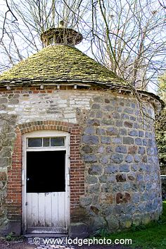 An old Dove Cote with traditional conical roof in Avebury, Wiltshire.
