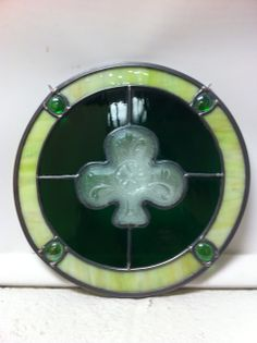 Luck of the Irish , Repurposed Shamrock candy dish in centre with Green water glass and lime green and glass bead border .