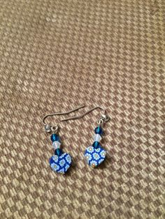 Cute deep blue heart earrings with daisies on the heart and Swarovski Crystal accents by RealBeadDesigns on Etsy
