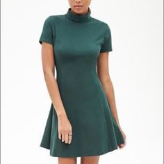 Forever 21 A line Turtleneck Dress Causal Olive Green A-Line dress featuring short sleeves, turtleneck, and princess seams down front and back. This A-line dress's features make it an all-weather dream. Short sleeves and a lightweight stretch fabric make it ideal for sunny days as well as chilly afternoons grabbing coffee with friends. This little dress pairs perfectly with plum ankle boots, and a Swarovski necklace, and a cropped leather jacket. Perfect for fall weather. • Like new…