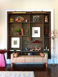 Stylish Ideas for Arranging and Organizing Bookcases | Traditional Home